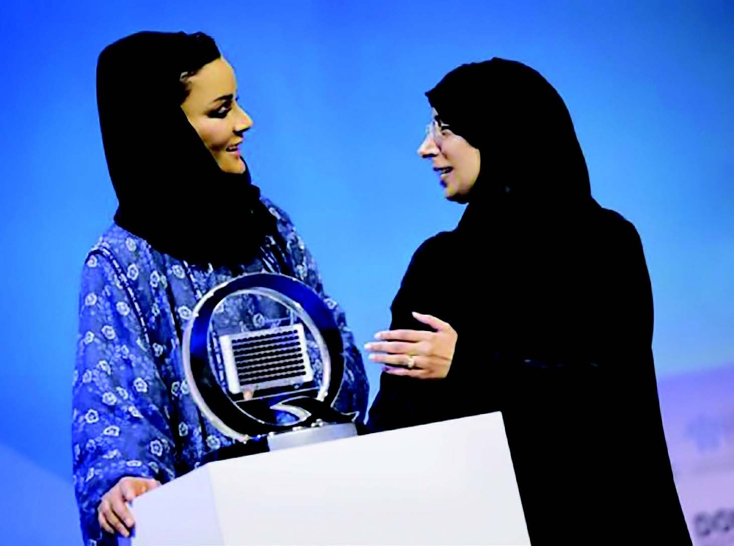 Dr. Hanan Mohamed al-Kuwari (right), Qatar's minister of public health, presents a model of the Q-chip to Her Highness Sheikha Moza bint Nasser, chairperson of the Qatar Foundation, at the World Innovation Summit for Health in November 2018.